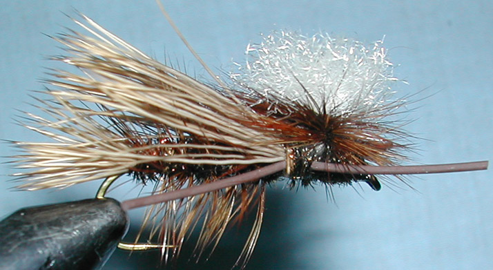 Madame X Parachute peacock trout fly